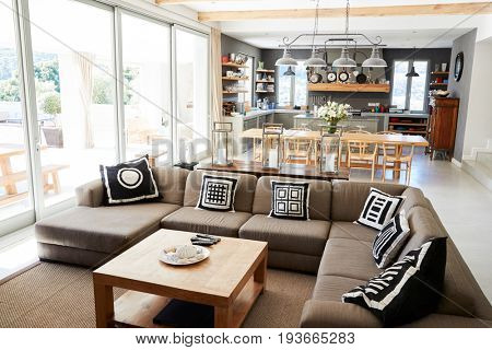 Home Interior With Open Plan Kitchen,Lounge And Dining Area