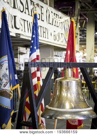 Ship Tour USS Kearsarge (LHD 3) Wasp-class amphibious assault ship: Brass bell presented to the ship in 1946 on display. Fleet Week NEW YORK MAY 25 2017.