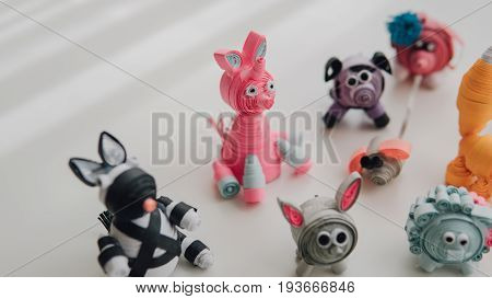 .cartoon Paper Toys Made By Own Hands Close-up. Toys Made By The Technology Of Quilling. Children's