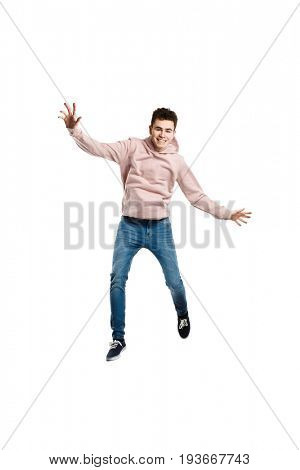 Young man jumping on white background