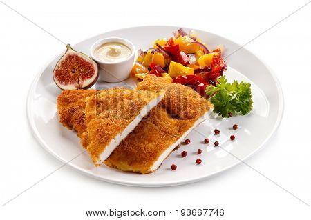 Fried pork chop coat in breadcrumbs and vegetable salad
