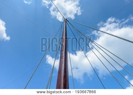 wooden sailing mast against the blue sky