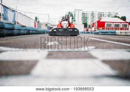 Karting racer on finish line, go kart competition