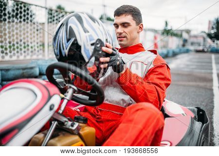 Go kart driver on karting speed track
