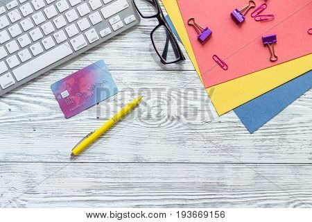 Money for education concept. Credit card, paper, glasses and keyboard on wooden table top view.