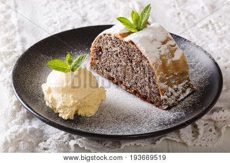 Sliced Poppy Strudel With Vanilla Ice Cream Close-up. Horizontal