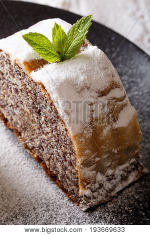 Freshly Baked Strudel Filled With Poppy Macro On A Plate. Vertical