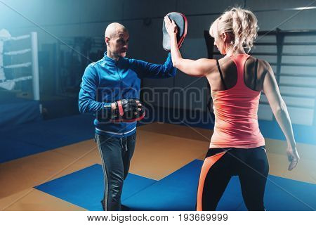 Womens self-defense workout with personal trainer