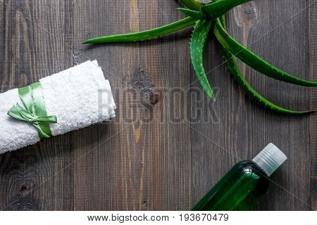 Organic aloe vera cosmetics. Aloe vera leafs, glass of aloe vera juice on wooden table background top view.