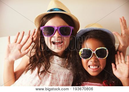 Portrait Of Two Girls Dressing Up In Bedroom Together