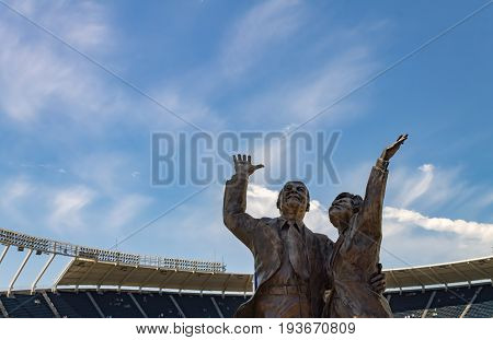 Kansas city Missouri United States- 6/26/2017 Ewing Marion Kauffman and Muriel irene Kauffman bronze statue at Kauffman Stadium