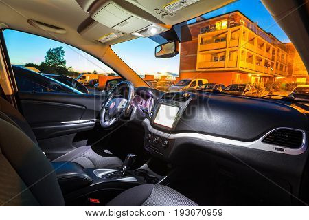 PRUSZCZ GDANSKI, POLAND - JUNE 7, 2017: Interior of Fiat Freemont SUV car captured at dusk with long exposure technique. Fiat Freemont is an european version of Dodge Jurney