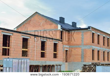 Building under construction. Construction of a new house made of bricks.