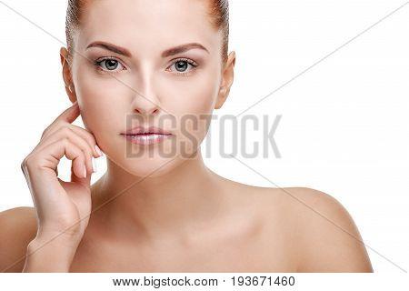 Portrait of young beautiful calm woman touching skin on her cheek