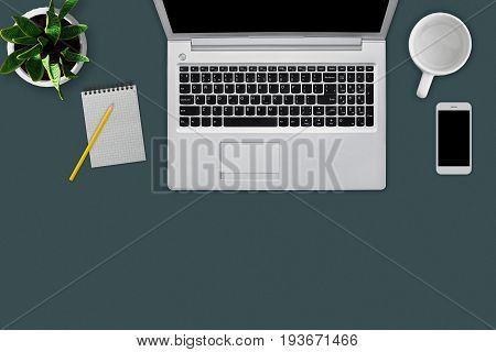 Modern Workplace With Digital Computer, Cell Phone, Mug, Blank Worksheet With Pencil, Green Plant. O