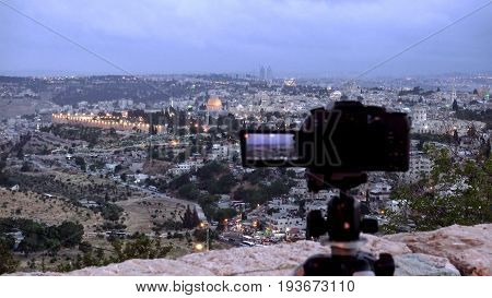 Camera shoots photo timelapse of the Jerusalem Old City view landscape. Mount Scopus is a famous Holy Land place and it has a fantastic view to the Old Jerusalem.