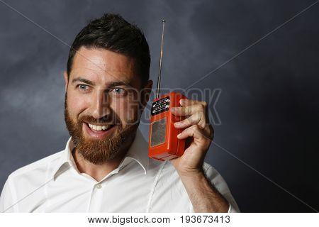 Nice man listen to the radio