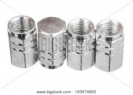 Silver aluminium tire valve caps isolated on white background