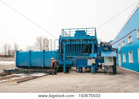 Preparation of a container with waste for subsequent transportation to a waste disposal plant. Waste processing plant. Business for waste sorting and processing. Cargo.