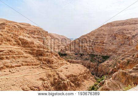 Wadi Qelt in Judean desert around St. George Orthodox Monastery, or Monastery of St. George of Choziba, Israel