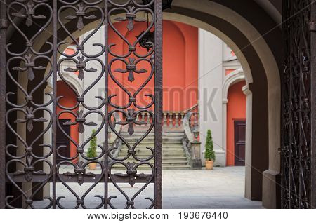IRON GATE TO THE YARD - Gate to the tenement house in the old town of Poznan