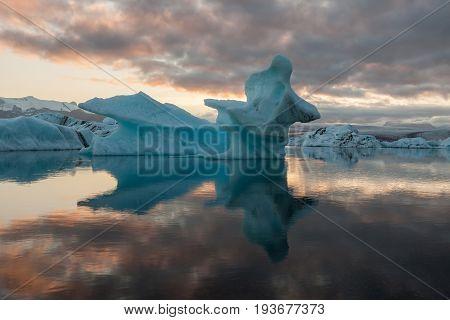 Melting Icebergs Reflections In Jokulsarlon Glacier Lagoon. Base Of The Vatnajokull Glacier At Jokul