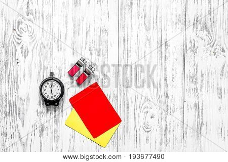 Football refereeing. Yellow and red referee cards, stopwatch, on wooden background top view.