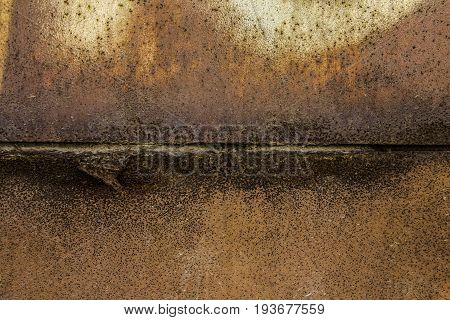 Two parts of Rusted metal plates texture with peeling metal along the joint close up