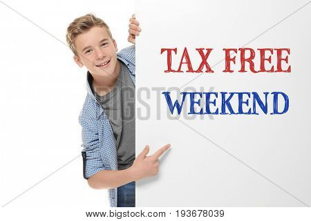 Teenager pointing on poster with text TAX FREE WEEKEND, white background
