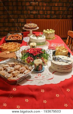 Festive Christmas desert table with red cloth.