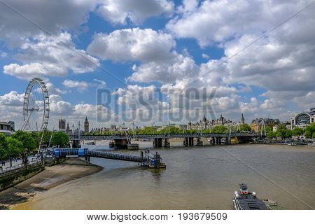 Festival Pier on the River Thames with London skyline. Taken late morning in early May with lovely cloudy and blue sky.