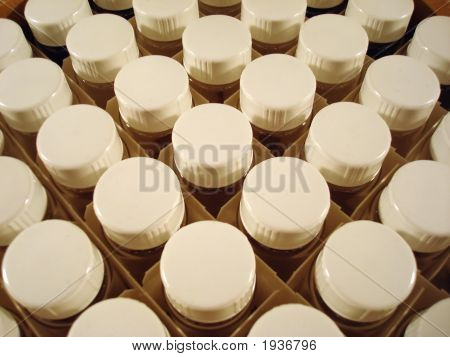 Crate Of Viles With White Lids