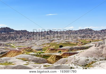 BADLANDS NATIONAL PARK, SOUTH DAKOTA - JUNE 22, 2017: Cars on the road through the Yellow Mounds area of Badlands National Park.