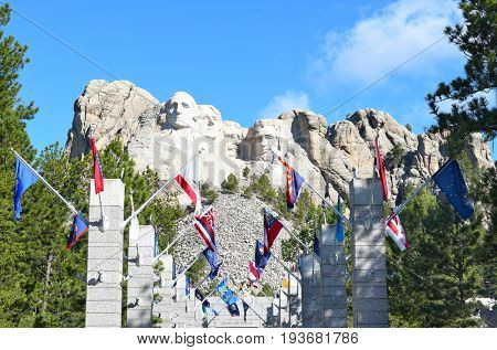 KEYSTONE, SOUTH DAKOTA - JUNE 23, 2017: Mount Rushmore National Memorial. Avenue of Flags with the monument in the distance.