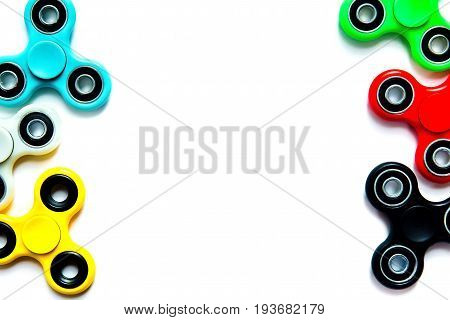 Fidget finger spinner anxiety relief toy on white isolated background copyspace. Concept relieving stress