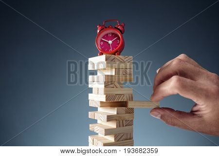 Planning, risk and strategy deadline time in business alarm clock on wooden blocks