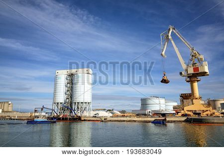 Port activities, commercial and maintenance in a cargo port.