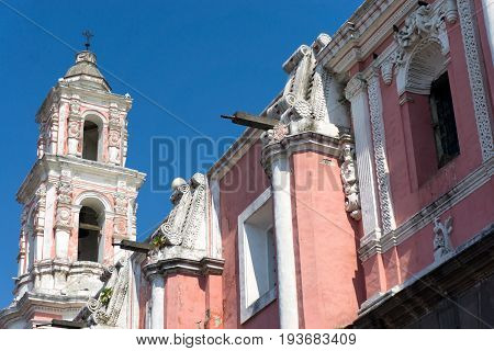 Pink bell tower of the Satan Catalina Church in Puebla Mexico