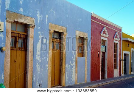 Street lined with colorful colonial buildings in Campeche Mexico