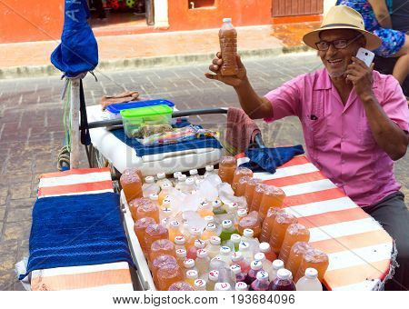 VALLADOLID MEXICO - FEBRUARY 11: Man selling juice on the street in Valladolid Mexico on February 11 2017