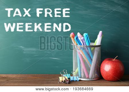 School supplies with text TAX FREE WEEKEND and blackboard on background