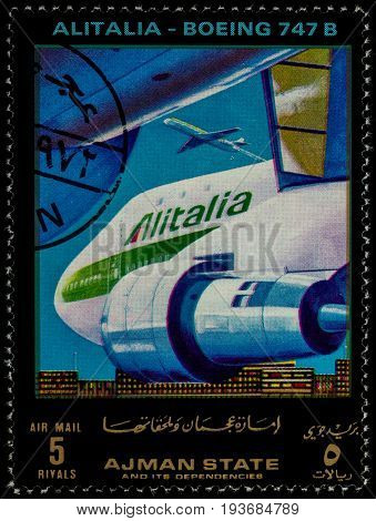 Moscow Russia - July 03 2017: A stamp printed in Ajman shows passenger airliner Boeing 747B Alitalia series