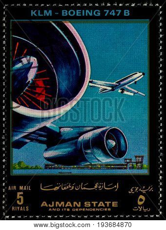 Moscow Russia - July 03 2017: A stamp printed in Ajman shows passenger airliner Boeing 747B KLM series