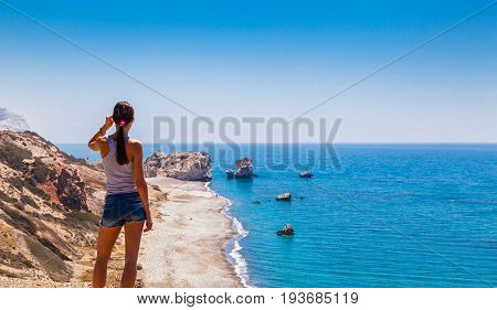 Woman Looks On Panoramic Landscape Petra Tou Romiou (the Rock Of The Greek), Aphrodite's Legenda
