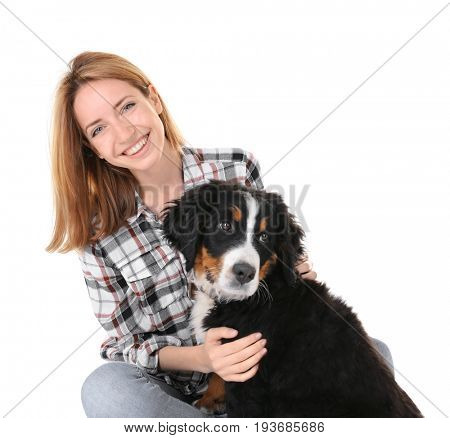 Young woman with cute funny dog on white background