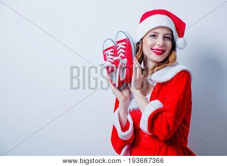 Santa Claus Girl In Red Clothes With Gumshoes