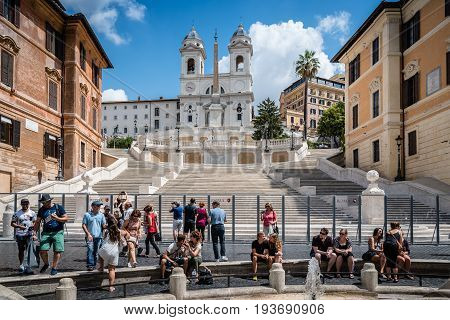 Rome Italy - August 18 2016: Piazza di Spagna and spanish steps to Piazza della Trinita dei Monti a sunny summer day. It is a main square in the historical centre of Rome.