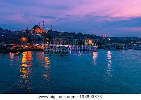 Landscape View Of Night City Near Of Galata Bridge, Istanbul, Turkey. Panoramic Seaview On Golden Ho