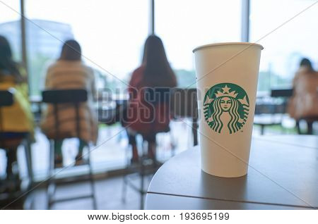 SHENZHEN, CHINA - JANUARY 11, 2015: close up shot of cup with hot coffee at Starbucks coffee shop in ShenZhen.
