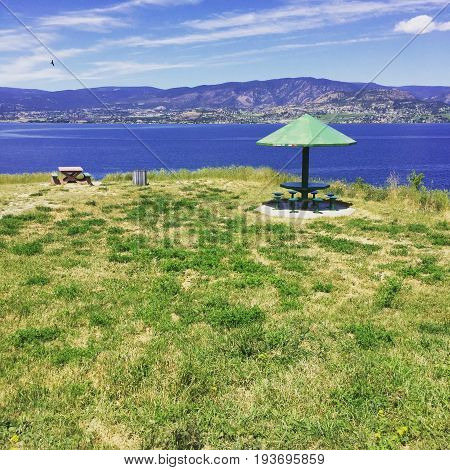 Picnic Area In Field Overlooking Lake